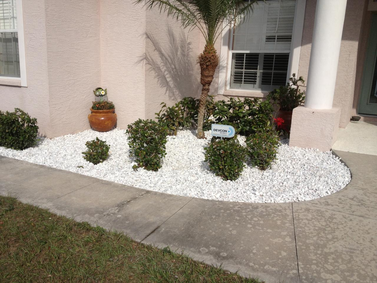 Green coast sprinkler lawn care our work for Large white landscaping rocks